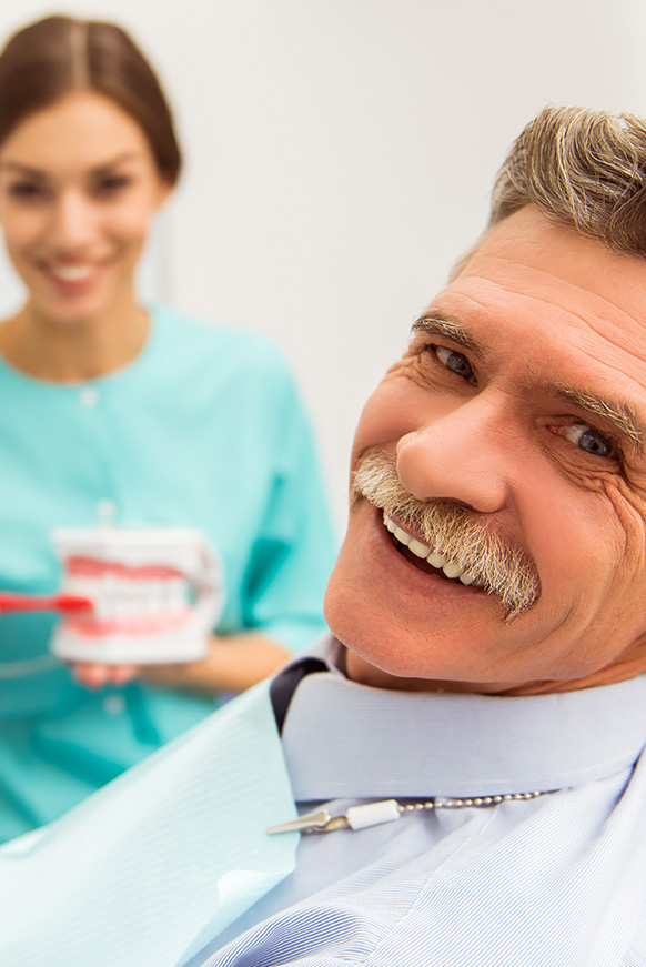 Mature man smiling in dental chair