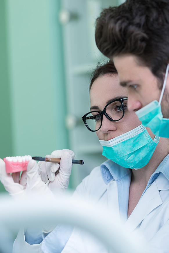 Dentist reviewing over denture implant