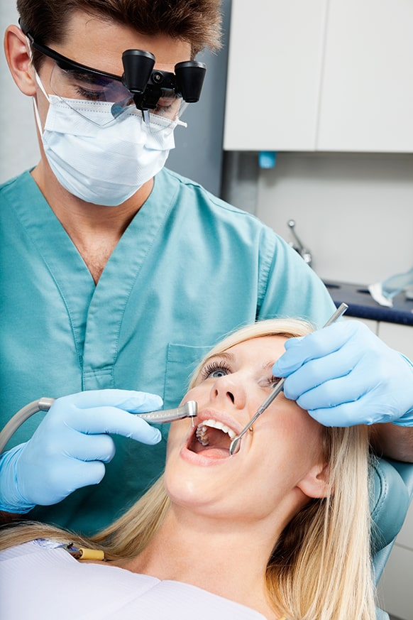 Woman receiving a root canal